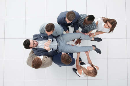 top view.a fun business team is rocking their leader Stock Photo