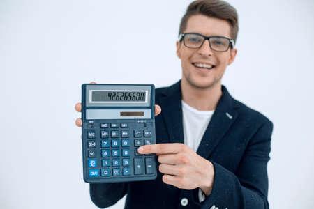 close up.smiling businessman showing calculator Banque d'images