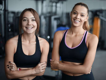 two young woman on the background of the gym