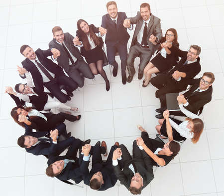 concept of team building .large successful business team sitting in a circle