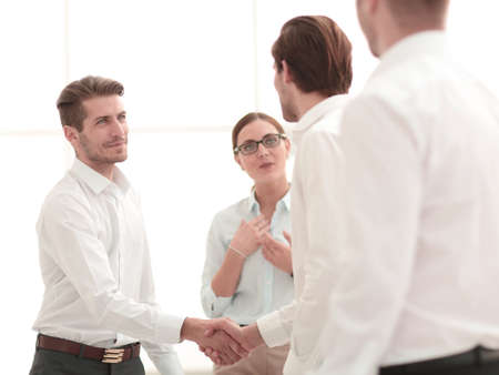 welcome and handshake of business partners