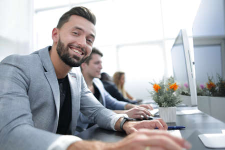 successful businessman working in a computer room Stock Photo