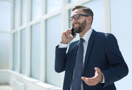 handsome businessman talking on mobile phone