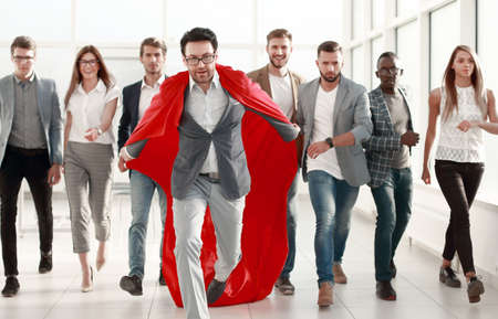 businessman in a red cloak heads the business team
