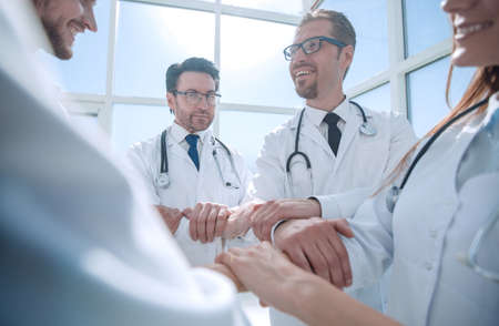 close up.a group of doctors standing in a circle