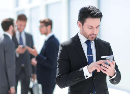 businessman looking at the smartphone screen