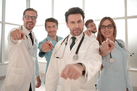 group of doctors and doctors pointing at you