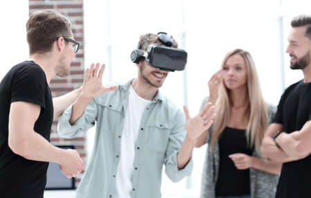 Positive colleagues testing virtual reality glasses Stock Photo