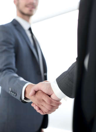 Happy businessman making handshake with businesswoman at meeting Фото со стока