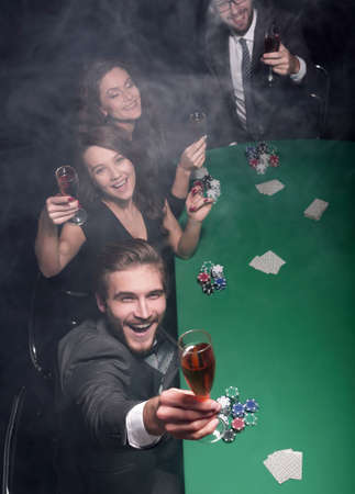 group of friends,spend a free evening in the casino