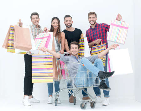 cheerful group of young people with shopping