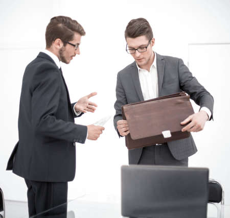 business colleagues talking while standing in office Stock Photo