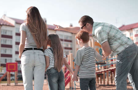 rear view.father shows his children their new home Stock fotó