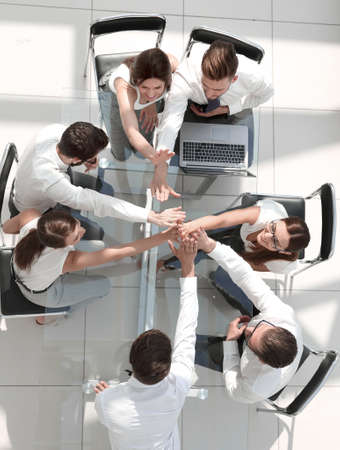 top view.employees of the company connecting the palms together