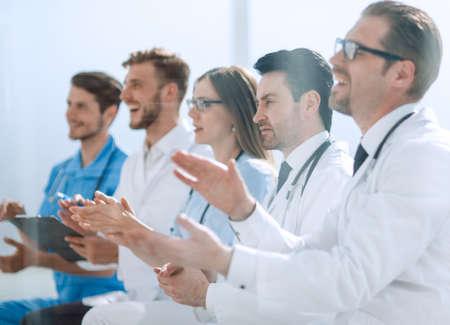 Medical team applauding in meeting