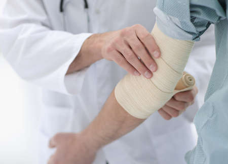 closeup.doctor applying elastic bandage Stock Photo