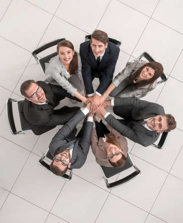top view.smiling business team making a tower out of hands Stock fotó