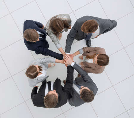 top view.professional business team with their hands folded together