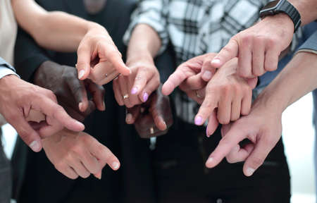 Hands of a group of unrecognizable circumcised young people Фото со стока