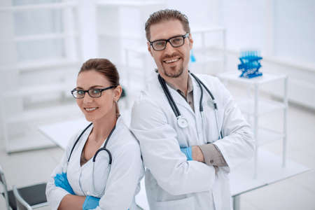 portrait of two young scientists on the background of the laboratory
