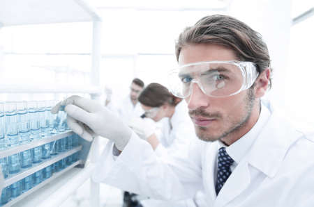 man in goggles to check fluid in vitro.