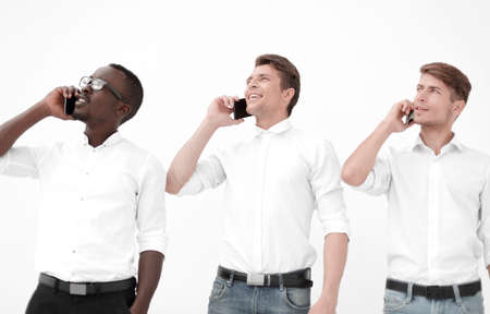 group of young people talking on mobile and looking away Stock Photo