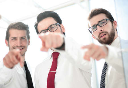 close up.confident business team pointing to you