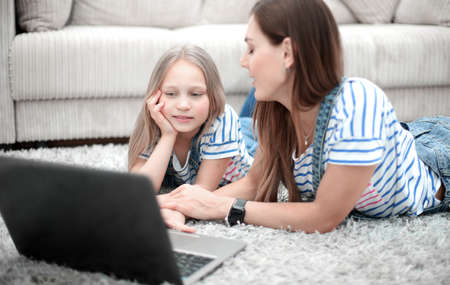mother and daughter using a laptop in their home Stock Photo