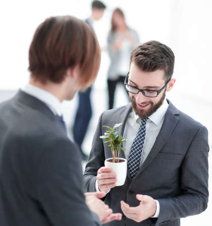 successful young businessman with young sprout