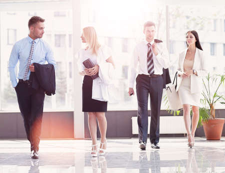 business people standing in the lobby of the modern office.