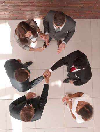 top view.business partners shaking hands