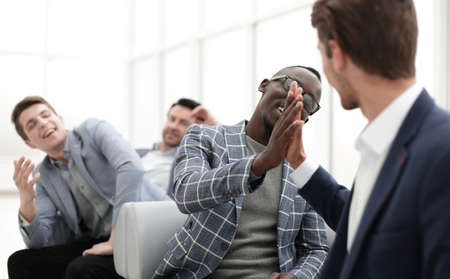 business people giving each other high five.