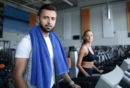 close up. an attractive man works in a modern gym