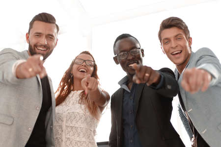 successful business team points to you