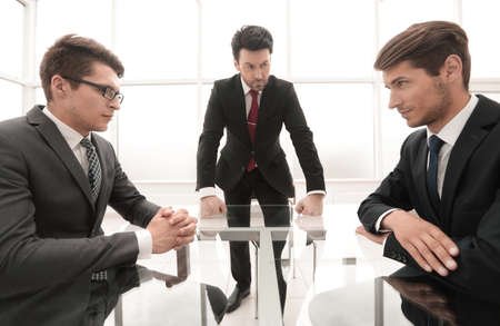 serious head holds a working meeting. business problem