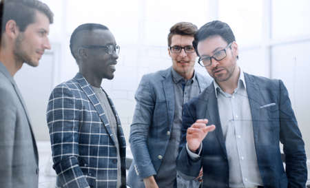 businessman discussing with the business team a new strategy of the company