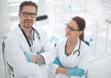 two researchers on the background of the laboratory