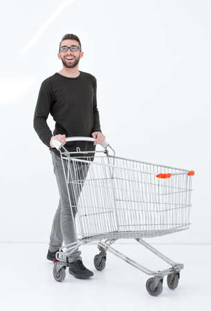 young man with a shopping cart steps forward