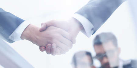 businessmen shaking hands closeup.business background 写真素材