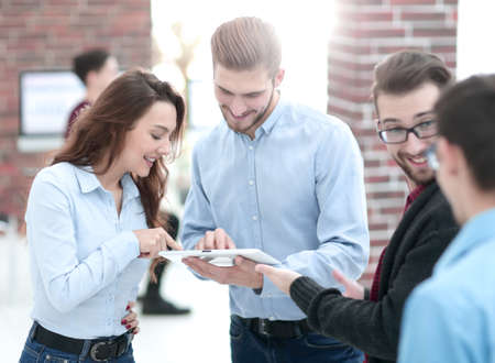 Happy  business people are using gadget, talking and smiling whi Stock Photo