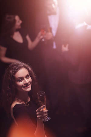 stylish young woman with glass of champagne Imagens