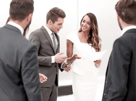 businessman and business woman discussing working paper