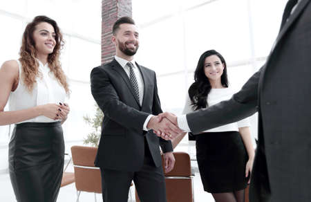 handshake of business people on the background of the office
