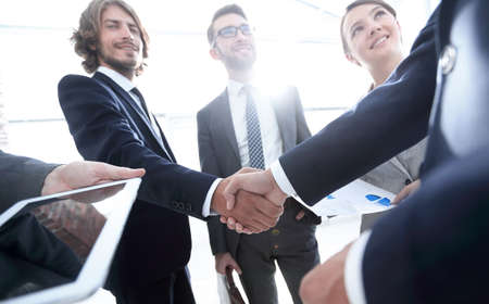employees look at the handshake business partners