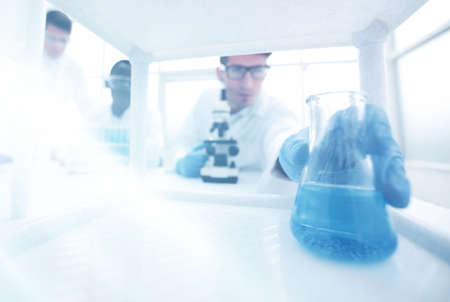 background image of scientists in the laboratory