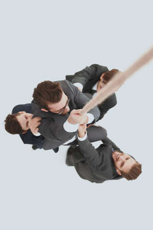 top view .business team helps the boss to climb up.