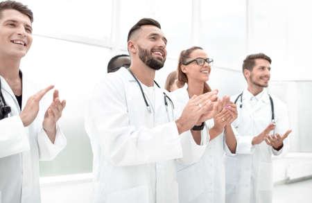 Doctors applaud at a conference 免版税图像