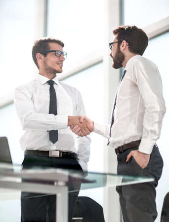 business people shaking hands with each other