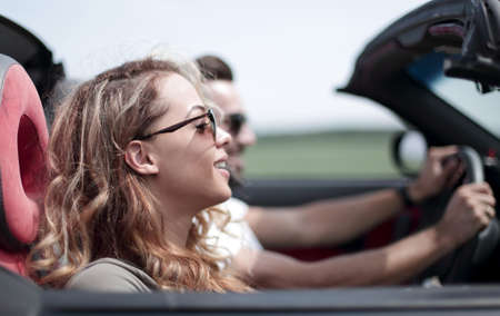 close up.couple traveling in their convertible car