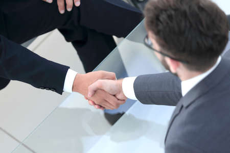 handshake Manager and the client in the office Banco de Imagens